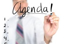 Businessman writing agenda