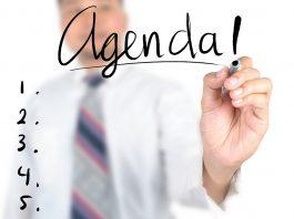 Businessman writing agenda